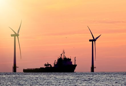 Image of a ship and wind turbines